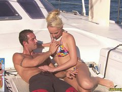 Diana Gold jerks and fucks a cock on the boat