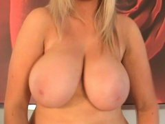 Ellie Jay presses her huge tits against glass